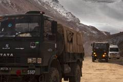 Trucks driving through the India/China border region