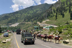 An Indian army convoy moves on the Srinagar-Ladakh highway at Gagangeer, north-east of Srinagar, on June 18, 2020.   | Photo Credit: AP
