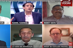 screenshot of people talking on news program