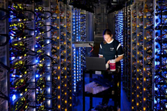 In this undated photo, an employee of Google diagnoses an overheated computer processor at the company's data center in The Dalles, Ore. Google uses these data centers to store email, photos, video, calendar entries and other information shared by its users. These centers also process the hundreds of millions of searches that Internet users make on Google each day. (Connie Zhou/AP/Google)