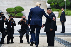 President Donald Trump steps into the northern side of the Military Demarcation Line that divides North and South Korea, as North Korea's leader Kim Jong Un looks on, in the Demilitarized zone (DMZ), June 30, 2019.