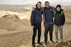 MIT graduate student Nicholas Rivera (middle) and two students from Professor Ido Kaminer's lab visit Masada National Park near the Dead Sea in Israel