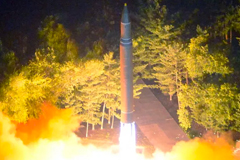 This July 28, 2017 photo released by North Korea's official Korean Central News Agency shows a Hwasong-14 intercontinental ballistic missile being lauched at an undisclosed location in North Korea. STR/AFP VIA GETTY IMAGES/GETTY