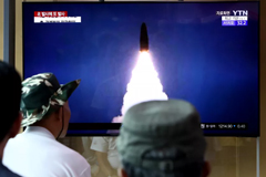 People watch a TV showing a file image of a North Korean missile launch at the Seoul Railway Station on August 6, 2019, in Seoul. Chung Sung-Jun/Getty Images