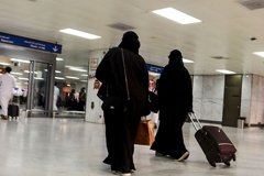 Saudi women roll at the departure hall of the Jeddah Airport on Aug. 6. Source: AFP via Getty Images