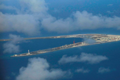 Chinese-held Subi Reef, a man-made island in the Spratly chain in the disputed South China Sea, is seen in April 2017. | POOL / VIA REUTERS
