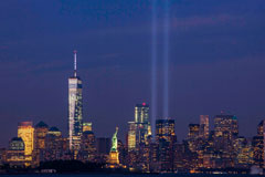 View of NYC with lights shining up from where Twin Towers used to stand to honor 9/11