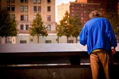 A man pauses by the National Sept. 11 Memorial in New York City. (Flickr/Sarah Le Clerc, https://flic.kr/p/dPcJkN; CC BY-ND 2.0, https://creativecommons.org/licenses/by-nd/2.0/)