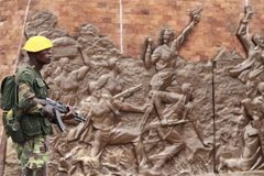 Standing guard at a monument in Harare, March 2011.