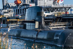 A Collins-class guided missile submarine is moored at Royal Australian Navy base HMAS Stirling, Australia. U.S. NAVY / MASS COMMUNICATION SPECIALIST 2ND CLASS JEANETTE MULLINAX