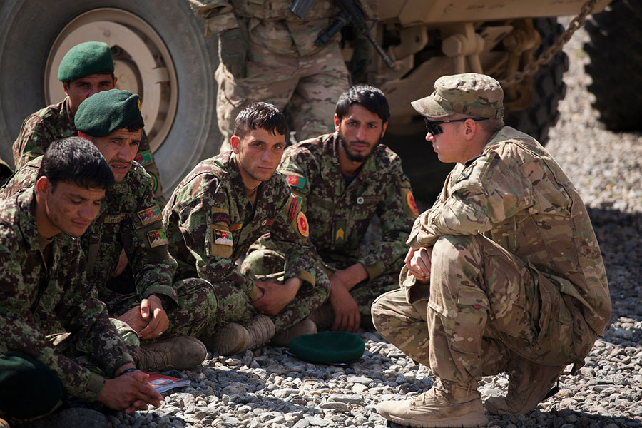U.S. Soldier in Afghanistan Caption: A U.S. Soldier speaks to a group of Afghan National Army Soldiers.