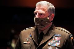 General Mark A. Milley is the 20th Chairman of the Joint Chiefs of Staff, the nation's highest-ranking military officer, wearing a mask.