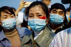 Young Chinese woman with face mask