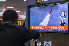 People watch a television broadcast reporting the North Korean missile launch at the Seoul Railway Station on October 31, 2019 in Seoul, South Korea.