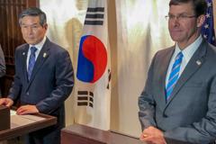U.S. Defense Secretary Mark Esper and his South Korean counterpart, Jeong Kyeong-doo, give a news conference in Bangkok on Sunday. | AP