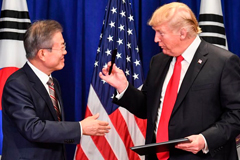 US President Donald Trump and South Korean President Moon Jae-in sign a trade agreement at a bilateral meeting in New York on September 24, 2018, a day before the start of the General Debate of the 73rd session of the General Assembly.  Nicholas Kamm / AFP/Getty Images