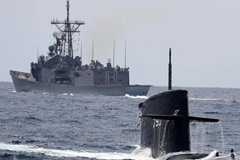 The 'Zwaardvis'-class submarine ROCS 'Hai Lung' surfaces near a Republic of China Navy frigate. REPUBLIC OF CHINA NAVY