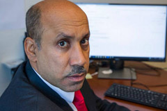 In this Oct. 26, 2018, photo Ali AlAhmed poses for a photograph in his office in Washington. Hackers are impersonating reporters in a bid to intercept the communications of the prominent Saudi opposition figure in Washington. An Associated Press review of malicious emails sent to AlAhmed shows he was approached by hackers masquerading as a BBC reporter and as Washington Post columnist Jamal Khashoggi, who was killed last month at the Saudi consulate in Istanbul.