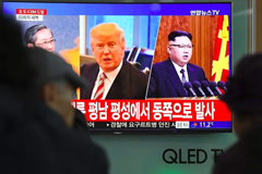 People watch a television showing pictures of President Trump and North Korean leader Kim Jong Un at a railway station in Seoul in November. (AFP/Getty Images)