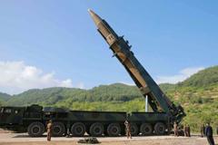 Kim Jong-un inspects an intercontinental ballistic missile in 2017 Credit: HOGP/AP