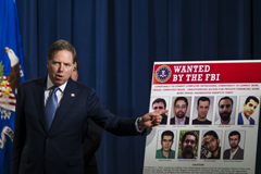 Geoffrey Berman, the United States attorney for the Southern District of New York, discussing the charges last year against nine Iranians accused of hacking into the systems of hundreds of companies and academic institutions.CreditCreditZach Gibson/Bloomberg