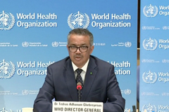 The head of the World Health Organization, Dr Tedros Adhanom Ghebreyesus speaking at a podium with the World Health Organization backdrop behind him