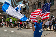 A man waving the flags of Israel and the United States in front of a rally in support of Palestine last week in Copley Square in Boston.