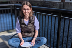 2018-19 J-WAFS Fellow Andrea Beck sits by the Charles River.