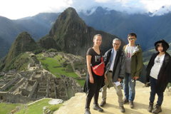 Posing with a panoramic view of Machu Picchu in Peru are (l-r) PhD student Paloma Gonzalez, Associate Professor Takehiko Nagakura, and two MIT graduate students.  Photo courtesy of MISTI