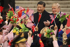 In this Nov. 9, 2017, file photo, President Donald Trump and Chinese President Xi Jinping participated in a welcome ceremony at the Great Hall of the People in Beijing.