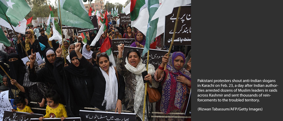 Pakistani protesters shout anti-Indian slogans in Karachi on Feb. 23, a day after Indian authorities arrested dozens of Muslim leaders in raids across Kashmir and sent thousands of reinforcements to the troubled territory. (Rizwan Tabassum/AFP/Getty Images)