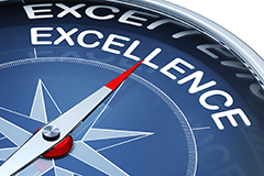 Compass pointed toward excellence