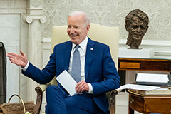 President Biden with Afghanistan war in background